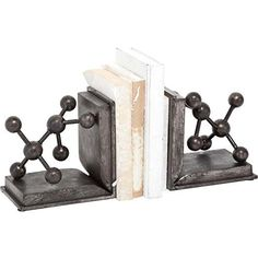 "Chemistry Home Decor - Molecule Home Decor  Incredibly popular molecule wall art is an incredibly cool type of chemistry wall art.  Chemistry home decor like this is especially popular for offices, gamerooms, dens and even kids great. Furthermore great for college stuents and dorm room decorating ideas. Also a great gift for science geeks  Mercana 57492 ""Mogg"" Decorative Bookends, Set of 2, 8"" x 8"" x 6"""