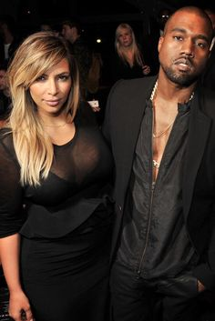 Kim Kardashian, Kanye West Front Row at Givenchy  [Photo by Stéphane Feugère]
