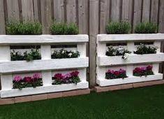 Afbeeldingsresultaat voor tuinafscheiding met pallets