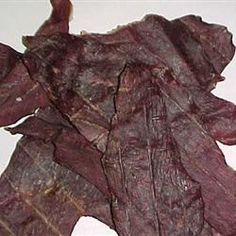 This jerky tastes just like the store bought kind. If you like those kinds, you'll enjoy this very much. Use Hickory smoked flavoring instead, if you'd like. Jerky Recipes, Beef Recipes, Venison Jerky, Homemade Beef Jerky, Road Trip Snacks, Glass Baking Dish, Liquid Smoke, Garlic Minced, 1 Pound