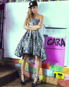 Favela funk: Cara Delevingne swapped the planet's fashion capitals for a Rio favela as she worked her magic in front of the camera in a street shoot for the February edition of Vogue Brazil, wearing a pretty grey strapless prom-style dress