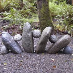 Rock garden - little things like this are so simple & add personality to a yard.  Love these little guys!