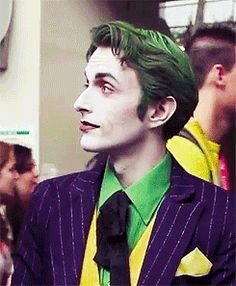 Awesome cosplay of the Joker. GIF. He's actually kinda cute. :)