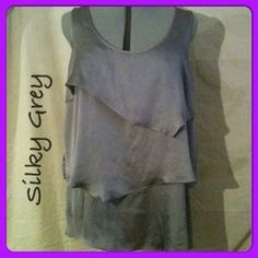 I just discovered this while shopping on Poshmark: Silky Grey Dress Top. Check it out! Price: $10 Size: L, listed by kmariec