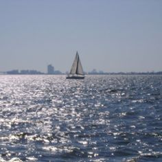 On sailboat watching another sailboat