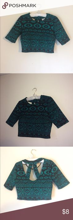 NWOT! Black and Turquoise Aztec Crop Top This Chris top is a size medium! In perfect condition! Also the back has cute cut outs😍😊 Forever 21 Tops Crop Tops
