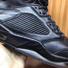 The Air Jordan 5 Premium Triple Black will release this July 2017 featuring an updated premium leather upper, Flight lace lock, and more. Detailed look: