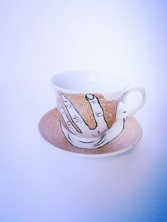 Set of teacups with screaming faces