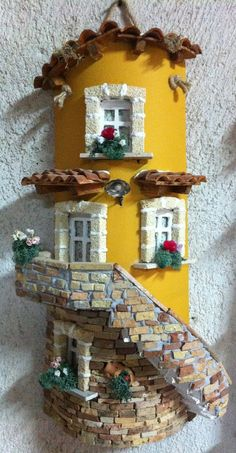 Arte na telha Clay Houses Miniature Houses Pottery Houses Doll House Crafts Paper Mache Crafts Diy Clay Bottle Crafts Fairy Houses Craft Tutorials Bookcase Shelves Bookcases Book Furniture Bookcase Closet Fairy House Crafts, Clay Fairy House, Doll House Crafts, Fairy Garden Houses, Garden Art, Fairies Garden, Miniature Crafts, Miniature Fairy Gardens, Miniature Houses