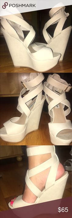 Steve Madden wedges Steve Madden platform wedge in size 6. Worn about 2 or 3 times. New condition. Light taupe/beige color. Two gold colored buckles on each shoe. Steve Madden Shoes Wedges