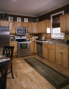 Maple cabinets stainless steel appliances and black for Chocolate kitchen cabinets with stainless steel appliances