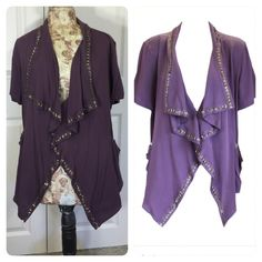 Elizabeth and James Purple Beaded Jacket Elizabeth and James Purple Beaded Jacket Small Elizabeth and James  jacket is soft to the touch, and fashionable to the eyes! It's free flowing waterfall draped collar is adored with small sequined flowers, and clasps in the front with a hook and eye. You can pair this over your favorite tank top with jeans or a pencil skirt! Elizabeth and James Tops