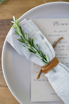 sprig of rosemary and leather lace on linen table napkin (tea towel would work too, makes for a nice oversized version)