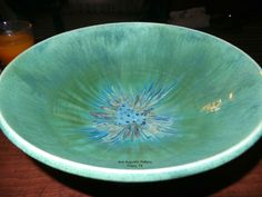 Wheel thrown large serving bowl. Glazed with Mayco Robins Egg, Potters Choice Seaweed and various Potters Choice blues. Electric fired to cone 6. Created by Ann Augustin Pottery, Frisco, TX.