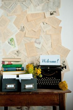 Book themed entry table with escort cards.