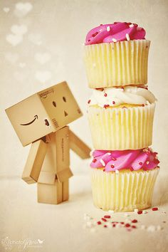 LOST DANBO, approximately 3 cupcakes high and is an adorable little cardboard robot, if seen please return it to me