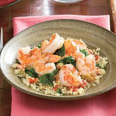 Couscous with shrimp and spinach.Couscous is made from cracked wheat,and picks up all the delicious flavours of this excellent dish. Delicious!!!