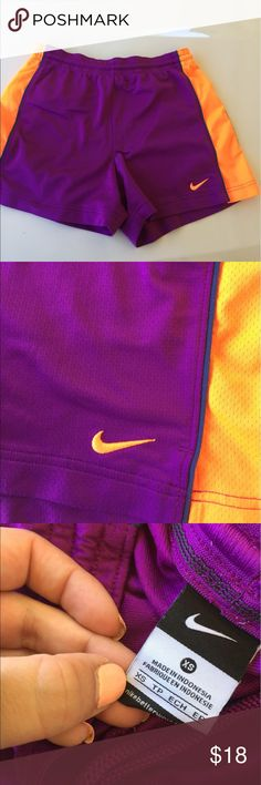 Nike Purple & Orange Shorts Nike athletics shorts. Love the color scheme here. Fit great! Nike Shorts