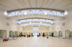 REED Academy - Pre-engineered metal building system, polycarbonate clerestories…