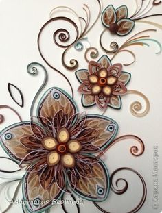 Pretty paper-quilled composition - this would look wonderful on my livingroom wall! Matches the Fall colors, even the brick fireplace... reminds me of peacock feathers!