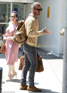 David Beckham shows off his man bun after touching down in New York Hair-raising: In keeping with a recurring trend of late, Beckham pulled his growing hair into a stylish top-knot that drew further attention to his famous features Mode David Beckham, David Beckham Style, David Beckham Fashion, David Beckham Hair, Fashion Mode, Fashion Outfits, Mens Fashion, Fashion Trends, Dating A Younger Man