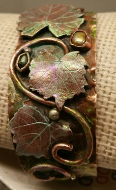 New copper bangle bracelet.  Copper muscadine leaves and wire.