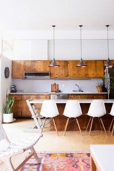 Pinned for the bar stool chairs. mid-century modern Kitchen design