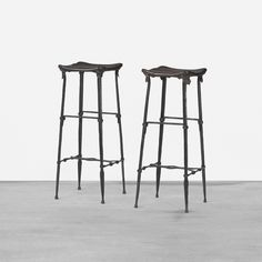 Lot 140: Sido and François Thevenin. Ups stools, pair. 1984, wrought iron, leather, brass. 14 w x 13¼ d x 34 h in. result: $8,750. estimate: $7,000–9,000. Signed with applied foil manufacturer's label to each example: [Sawaya and Moroni Milano Made in Italy]. Provenance: Private collection, Lugano, Switzerland