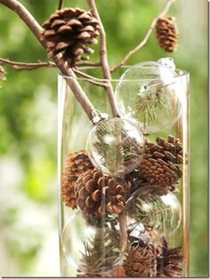 Pinecones and clear ornaments in a glass vase. Simple and pretty!