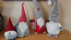 This listing is for one fabric Holiday Gnome. Felt, woolen and knit fabrics in red and grey with long white fabric beards. 2 different designs to choose from: - Gnome with Snow Cap (SOLDOUT) - Gnome with grey Cap and red polka dots (ONLY 2 left) I recommend placing your orders early on