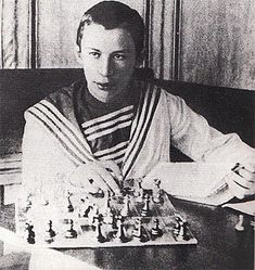 A young Sergey Prokofiev with his inseparable board  and chess books.