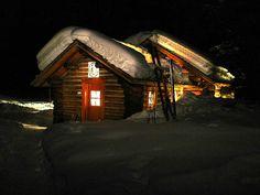 Ski poles propped up ..snow..mountains..cozy!