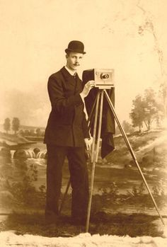 Cameras of 1890 - Albumen Print of Photographer with his Studio Camera and Petzval Lens. Image circa 1890.