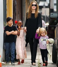 Family business: Three of Angelina Jolie's six children - Pax, Zahara, and Vivienne - will make their big-screen debuts in her upcoming live action film Maleficent