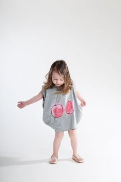 that little girl is adorable!  i would definitely get a shirt like this for my sister and my cousins <3