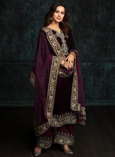Deep Plum and Wine Velvet Palazzo Suit features a velvet kameez with santoon inner, dhupioni silk palazzo pants and net dupatta. Embroidery work is completed with zari, sequins and stone work embellishments. Pakistani Formal Dresses, Pakistani Dress Design, Pakistani Outfits, Indian Dresses, Indian Bridal Fashion, Indian Wedding Outfits, Indian Outfits, Outfits Quotes, Velvet Dress Designs