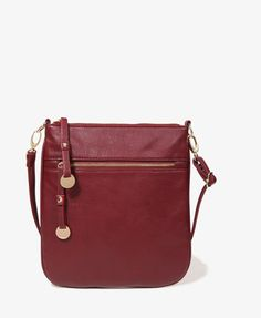 We love this Zip Pocket Crossbody bag in Burgundy from Forever 21!