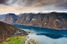 Norwegian Heritage. Moody weather brings out the dramatic textures of the cliffs surrounding Naeroyfjord overlooking Aurland. The Norwegian fjord is a World Heritage site and was  rated by the National Geographic Society as the world's number one natural heritage site. Photo: John & Tina Reid