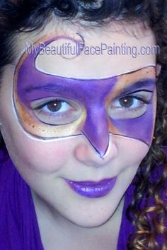 Purple and gold Mardi Gras mask in face paint