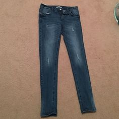 distressed denim jeans Dark blue distressed denim jeans, worn a few times. Great condition! Low waist, functional pockets. Forever 21 Jeans Skinny
