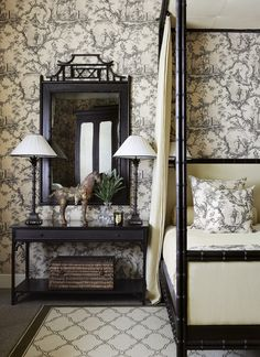 Toile wallpaper on the walls with Asian inspired furniture! John Jacobs Interiors.