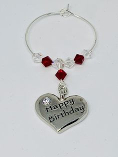 Happy Birthday Garnet Wine Glass Charm - set with a silver plated heart engraved with Happy Birthday - finished with Garnet and Clear Swarovski Crystals Garnet is the birthstone for January Wine Glass Charms, Organza Bags, Heart Charm, Birthstones, Garnet, Swarovski Crystals, January, Bubbles, Happy Birthday