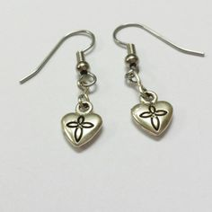 Check out this item in my Etsy shop https://www.etsy.com/listing/209058429/dangle-silver-heart-earrings