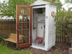 Vintage Upcycle Project DIY- four doors, a floor and roof. Cool garden storage. Must make one near my vegetable garden to keep tools/supplies handy.
