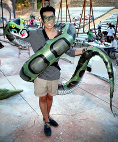I like how the actor's costume doesn't have to be complicated because they are controlling the snake puppet