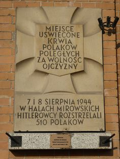 """A """"Tchorek plaque"""" on the western wall of the Hale Mirowskie which commemorates the 510 people who were murdered here by the Germans on 7th and 8th August 1944 - one of many such atrocities that took place during the Wola massacre...."""