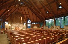 Christ the King Catholic Church, Pine Mountain, GA. Constructed 2006. A 400 seat church makes use of the natural materials of stone, concrete, wood, and glass. A contemporary interpretation of a traditional church is expressed with transepts on either side of the sanctuary. This is accentuated by a cupola positioned over the altar as a source of natural light. A large series of windows on the north side of the nave merge the picturesque outdoor setting with the serenity of the interior…
