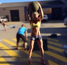 Overhead Medicine Ball Slam.  Great exercise for back, glutes, hips, thighs and shoulders.