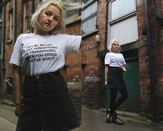 Get this look: http://lb.nu/look/8769829  More looks by Izzy McLeod: http://lb.nu/muccycloud  Items in this look:  Redbubble Why Be Racist, Sexist, Homophobic Or Transphobic Tee, Pull & Bear A Line Button Up Denim Skirt, Dr. Martens Metallic Docs   #casual #ethical #street #lgbt #activist