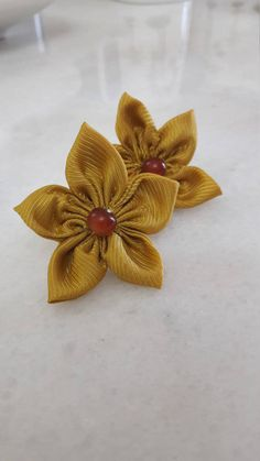 Check out this item in my Etsy shop https://www.etsy.com/listing/517501355/yellow-mustard-kanzashi-flower-stud